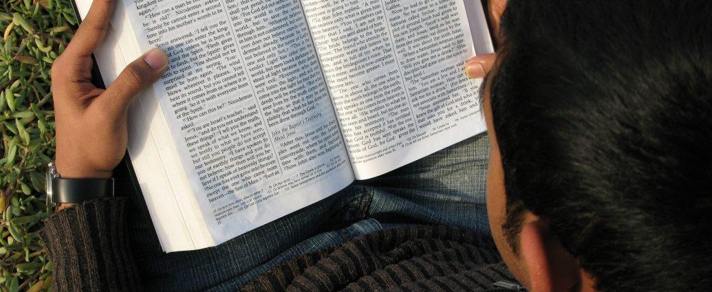 Man reading John's Gospel