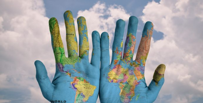 World map on a pair of hands