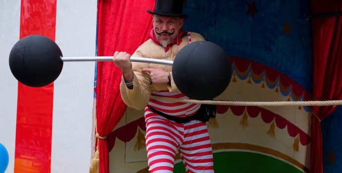 weight-lifter at a carnival
