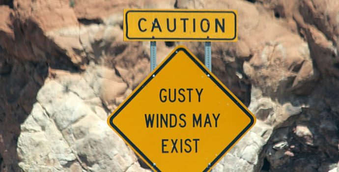 signpost saying gusty winds may exist